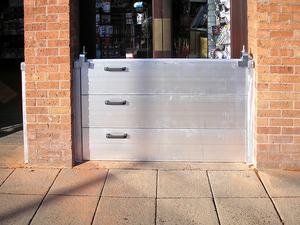 Removable flood barriers for retail areas at risk.